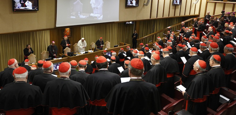 Pope Francis leads opening prayer during a meeting of cardinals in the synod hall at the Vatican Feb. 20. The pope asked the world's cardinals and those about to be made cardinals to meet at the Vatican Feb. 20-21 to discuss the church's pastoral approach to the family. (CNS photo/Paul Haring) (Feb. 20, 2014) See POPE-FAMILY Feb. 20, 2014.