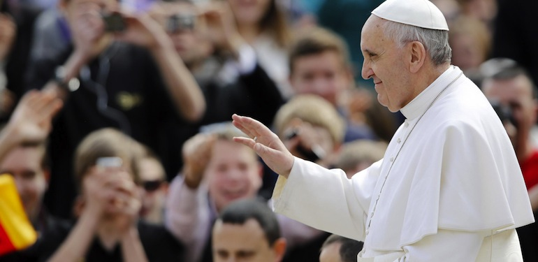 Pope Francis waves as he is driven through the crowd during his general audience, in St. Peter's Square, at the Vatican, Wednesday, March 27, 2013. (AP Photo/Andrew Medichini)