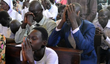 JUBA, SOUTH SUDAN - DECEMBER 25:  People attend a Christmas mass at the Cathedral of St. Therese to celebrate the birth of Jesus Christ, in Juba, South Sudan on December 25, 2014. Samir Bol / Anadolu Agency